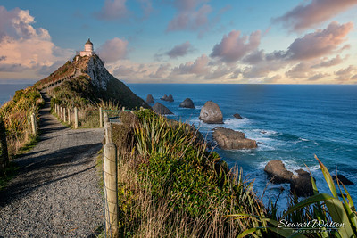The path leading to the historic landmark Nugget Point Lighthouse and its amazing surrounding rock and island formations