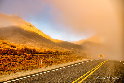 A glimpse of the sun through thick low cloud in Lindis Pass