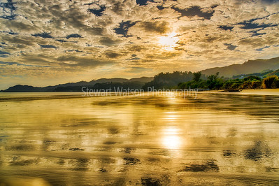 The golden sand reflections  of Pohara beach at sunset