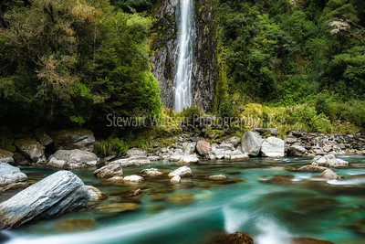 Spectacular waterfall in bush at Thunder Creek Falls, Haast Mt Aspiring National Park New Zealand