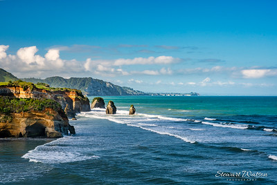 The stunning Taranaki coastline at Tongaporutu with Mt Taranaki in the distance