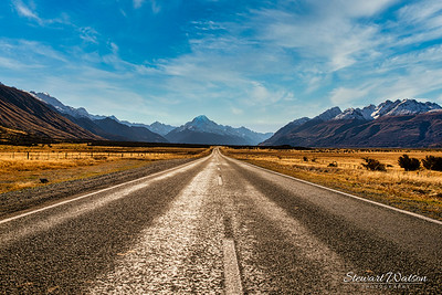 Zoom in and check out the tourists taking photos at the end of the end of the road.  Lake Pukaki en route to Hooker valley track in Aoraki Mt Cook National Park