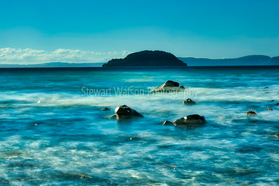 Long exposure of a stormy lake Taupo coastline in New Zealand