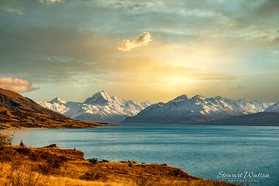 Lake Pukaki cloudscape with Aoraki Mount Cook and the Southern Alps at dusk