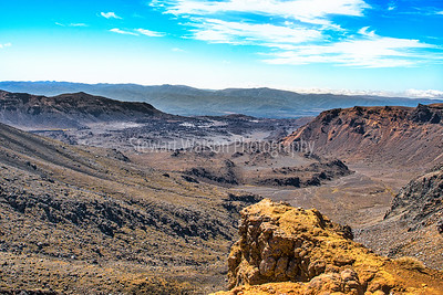 The vastness of the volcanic terrain of the Tongariro crossing from near the summit of Mt Ngauruhoe