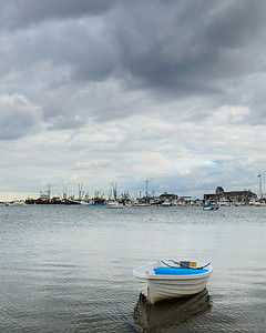 Lone dinghy in Provincetown Harbor