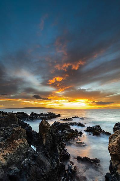 Keawakapu beach volcanic rock versus the sea