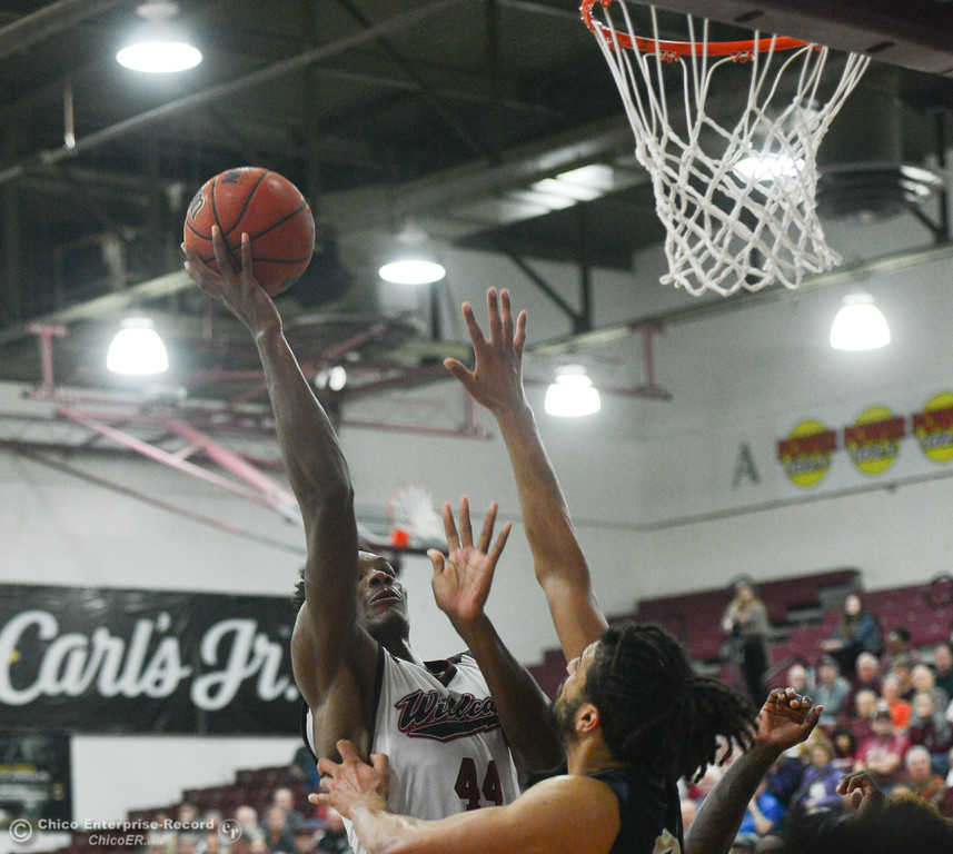 . Chico State\'s Dalton Smith goes up for a shot against Monterey Bay\'s Gregg Polosky (51), Thursday, February 1, 2018, in Chico, California. (Carin Dorghalli -- Enterprise-Record)