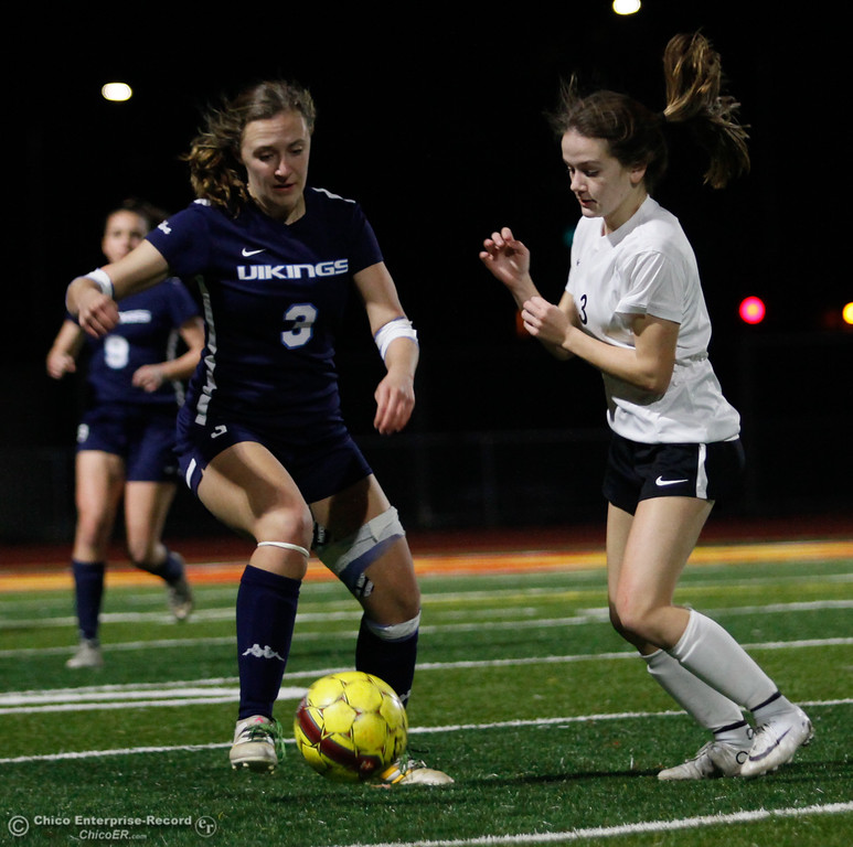 . Pleasant Valley\'s Jillian Weber (left) tries to keep possession of the ball as Chico High\'s Riley Freeman (right) attacks, Friday, January 19, 2018  in Chico, California. (Carin Dorghalli -- Enterprise-Record)