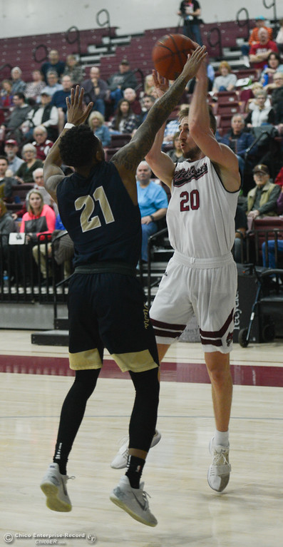 . Chico State\'s Blake Tuthill (20) goes up for a shot against Monterey Bay\'s Jonquis Bouyea (21), Thursday, February 1, 2018, in Chico, California. (Carin Dorghalli -- Enterprise-Record)