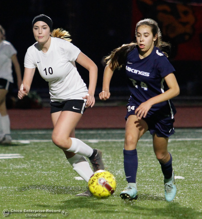 . Chico high\'s Abby Ularte (10) and Pleasant Valley High\'s Vanessa Raygoza (24) fight for the ball, Friday, January 19, 2018  in Chico, California. (Carin Dorghalli -- Enterprise-Record)