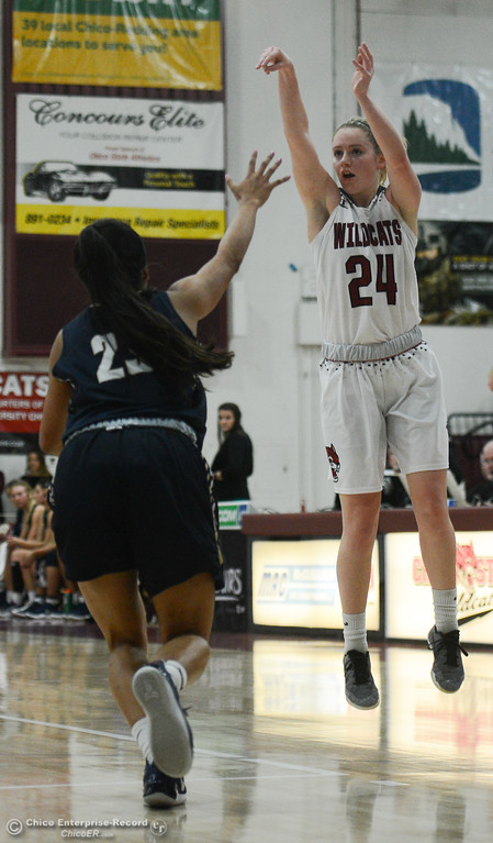 . Chico State\'s Vanessa Holland (24) goes up for a shot against Monterey Bay\'s Christine Golfo (23), Thursday, February 1, 2018, in Chico, California. (Carin Dorghalli -- Enterprise-Record)