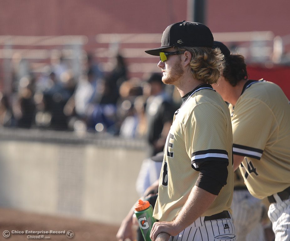 . Butte\'s Justin Bench watches the game from the dugout during Butte\'s game against Folsom at Butte College, Saturday, January 27, 2018, in Chico, California. (Carin Dorghalli -- Enterprise-Record)
