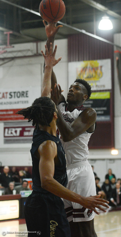 . Chico State\'s Dalton Smith (44) goes up for a shot against Monterey Bay\'s Gregg Polosky (51), Thursday, February 1, 2018, in Chico, California. (Carin Dorghalli -- Enterprise-Record)