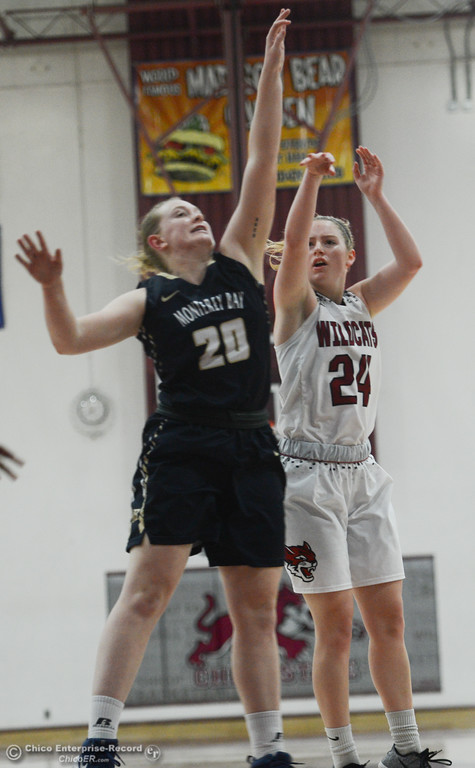 . Chico State\'s Vanessa Holland (24) goes up for a shot against Monterey Bay\'s Emily Hardin (20), Thursday, February 1, 2018, in Chico, California. (Carin Dorghalli -- Enterprise-Record)