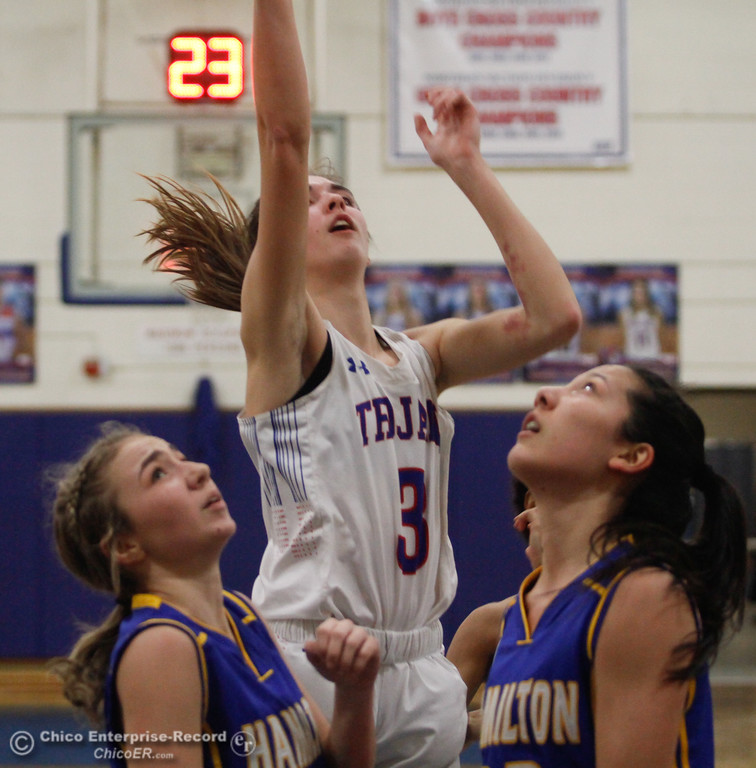 . Durham\'s Lindsey Bryant (3) goes up for a shot against Hamilton\'s Kathryn Dowdy (32) and Berenize Trujillo-Mendoza, Thursday, January 25, 2018 at Durham High School in Chico, California. (Carin Dorghalli -- Enterprise-Record)