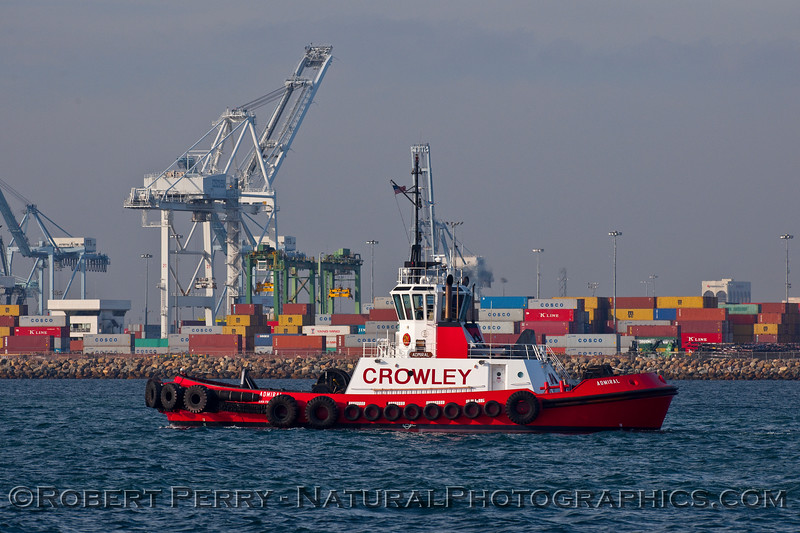 "Crowley towboat ""Admiral"" with hammerheads and containers in the background."