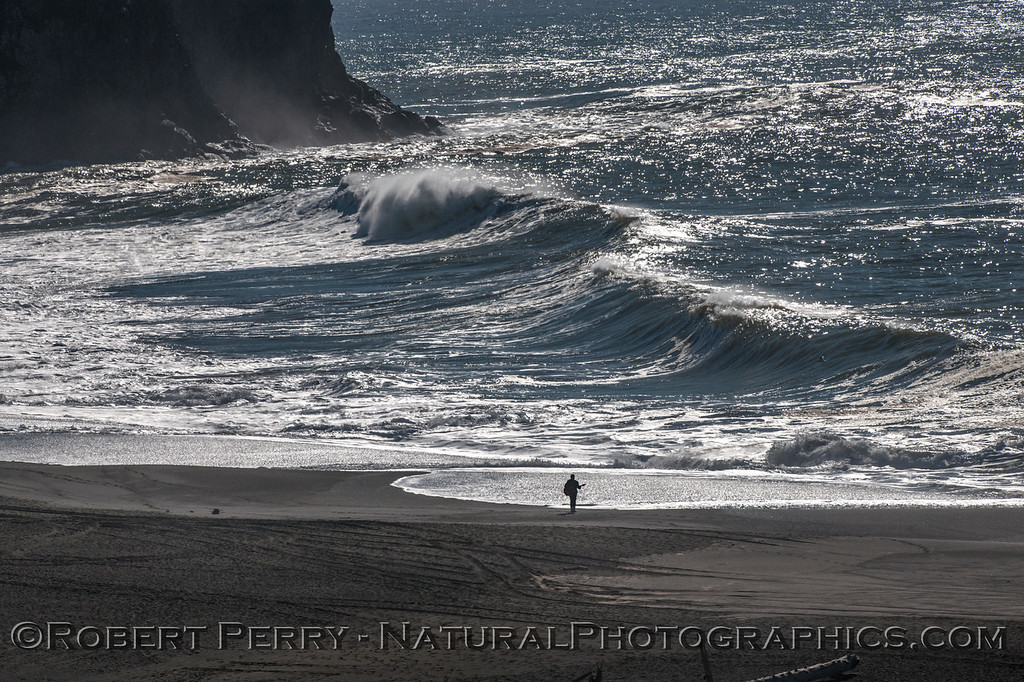 Lone guitar player, big surf, Russian River mouth.