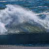 Wave hits old jetty.