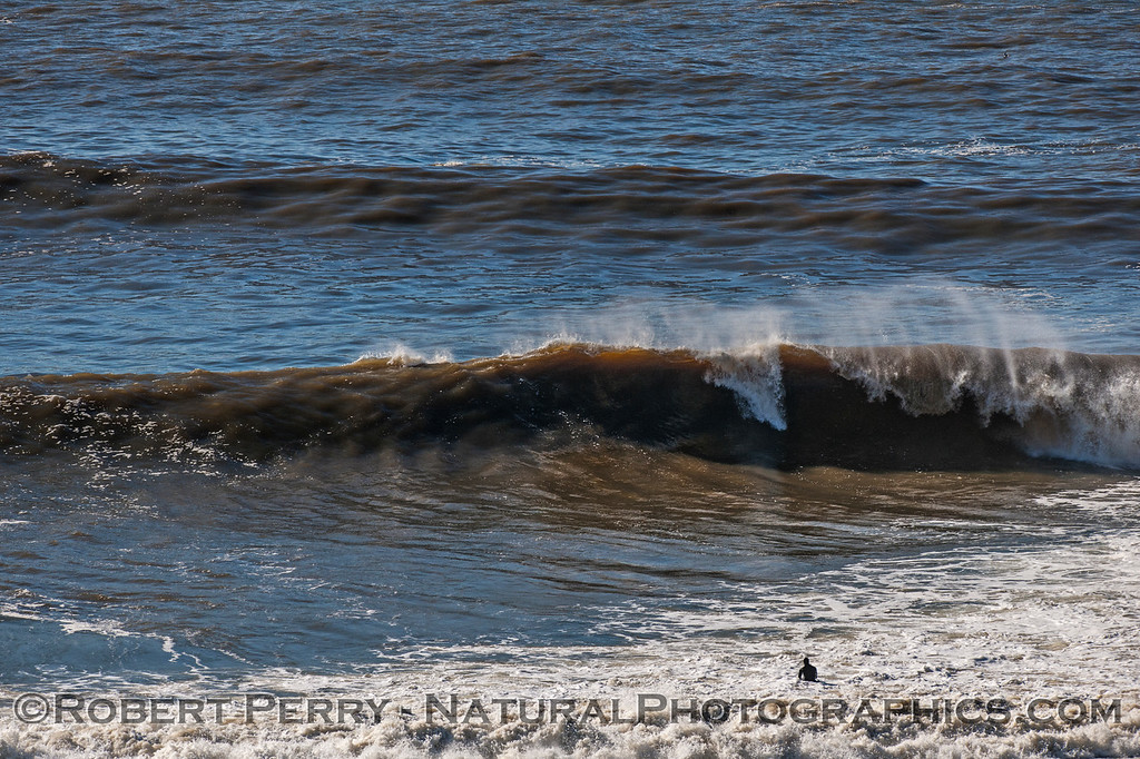 Lone surfer and big muddy waves - Russian River mouth.
