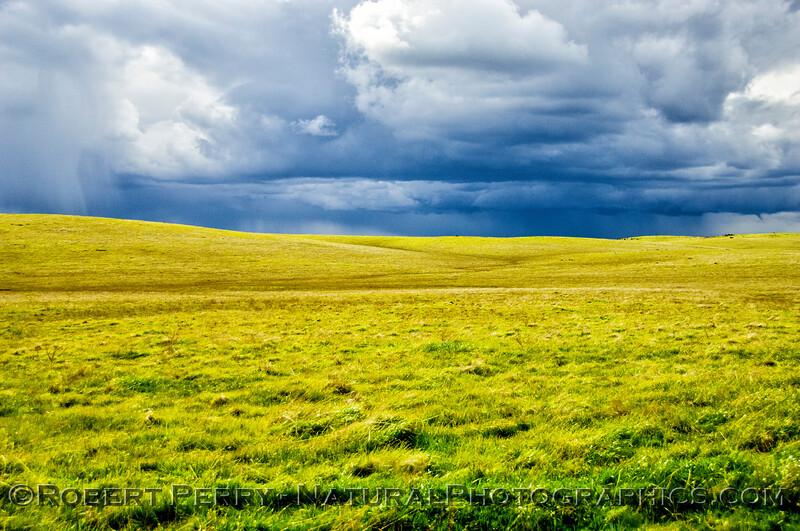 Storm cells approach the open grasslands.