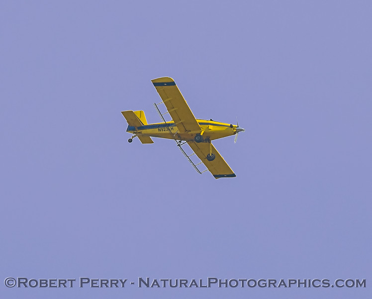 A yellow-bellied Round-Up sprayer, in flight.