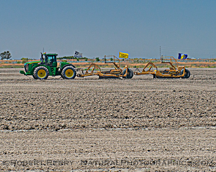 tractor towing machines with flags in field 2020 06-28 Sutter & Yolo ByPass-b-043