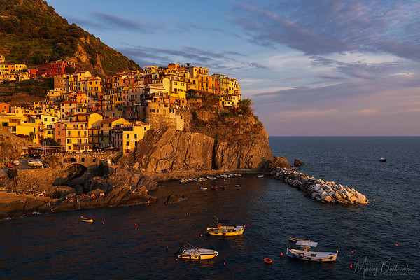 In a place like this, which has been photographed to death, only spectacular and unusual weather conditions can make the photo to stand out. This time it wasn't a case so it came out as a decent golden hour shot. Manarola, Cinque Terre, Liguria, Italy