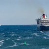 Queen Mary 2 preceeds Ventura out of Southampton Water