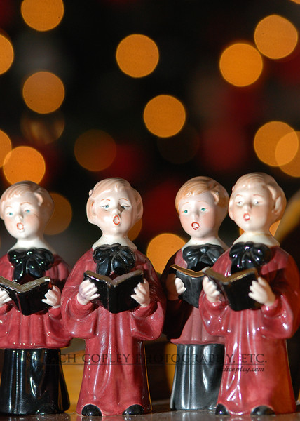 Dec. 16, 2011 - These singers were made by my Great Aunt Mattie and have been a Christmas decoration in my mom's home since I was a kid. On the last day of my Virginia Beach visit, I lined them up with mom's Christmas tree as a backdrop and shot with a 70-200, f2.8 lens to blur the lights as much as possible. The singers were lit with a flash clamped to the top of a chair (I brought limited gear on this trip) triggered with my new Pocket Wizards. (1/366)