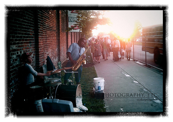 May 5, 2012 - I shot a number of photos at the Derby, Saturday; even one or two that might end up in the paper. But I think my favorite of the day is this one of buskers along the outside wall of Churchill Downs after the race. (142/366)