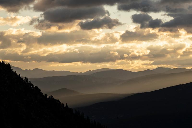 Hazy skies and sunrise rays mix over Summit County.  Breckenridge, CO.