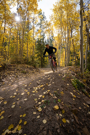 A mountain biker exits a turn on the famous Aspen Alley trail, Breckenridge, CO.