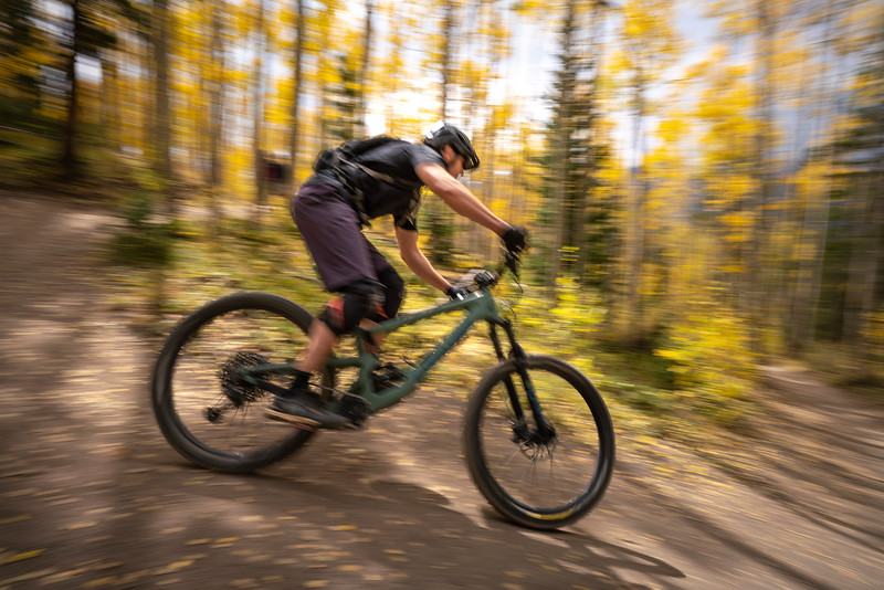 A mountain biker carves a turn on the Aspen Alley Trail, Breckenridge, CO.