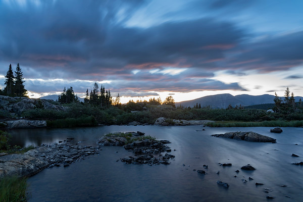 Clouds streak by as the sun is about to rise over Mohawk Lake, Breckenridge, CO.