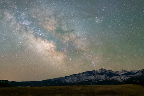 March 3rd at 5:00 AM as the Milky Way rises over the Sangre de Cristo Mountains towards Westcliffe , CO.   This is a stack of 31 shots.