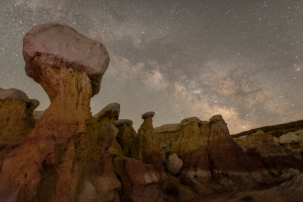 "Paint Mines Interpretive Park, Calhan, CO.  March 26th.  For the sky/galaxy I stacked 40 individual 15"" images together in Starry Landscape Stacker to reduce noise.  For the foreground I did one 7-minute exposure at a low ISO to reduce noise."