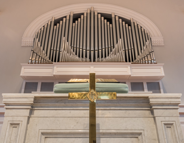 Cross, pulpit, bible, and organ