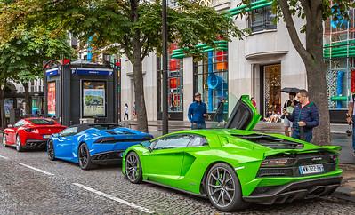 Two Lamborghinis and a Ferrari