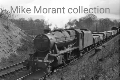 Stanier 8F 2-8-0 no. 482?7 almost certainly somewhere on the S & C. I had thought that the motion blurred number was 48277 but that seems to be unlikely in that location. [Mike Morant collection]