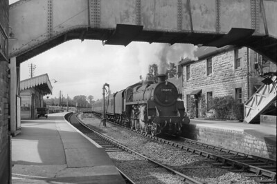 An evocative shot at Evercreech Junction station on the erstwhile Somerset & Dorset's metals features BR Standard 4MT 4-6-0 no. 75073 about to depart southwards whilst in charge of the 4.16 p.m. Evercreech to Templecombe service and note the Maunsell corridor stock. 75073 was a Swindon product and was allocated to Bath Green Park shed when this shot was taken on 15/9/60 but would move to Templecombe mpd where withdrawal would come in December 1965. [Mike Morant collection]
