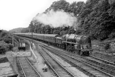 This undated view of BR Standard 9F 2-10-0 no. 92220 Evening Star was taken at Writhlington near Radstock and almost certainly, judging by the number heads hanging out of the windows, depicts the final Down S&DJR 'Pines Express' on its journey from bath Green Park to Bournemouth West which dates it as September 8th, 1962. The 'Pines' continued until 1967 but ran via Oxford, Basingstoke and Southampton. [Mike Morant collection]