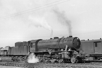 Austerity 2-8-0 no. 77070 at Perth on 18/6/49. 77070 was built by NBL at its Hyde Park Works in Glasgow in July 1943 and was taken directly into LNER stock which was the first of two periods of loan to the LNER. 77070 was taken into to BR stock in December 1948 and allocated to the Scottish Region's Thornton Junction depot where it was allocated when this shot was taken. BR branding and renumbering as 90359 were applied in December 1950 and 90359* would remain at Thornton Junction until December 1959 when it was reallocated to Grangemouth where withdrawal would come in November 1963. [H. C. Casserley / Mike Morant collection]