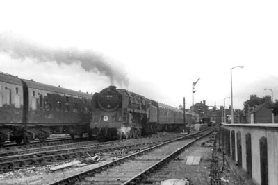 The prototype BR Standard 9F 2-10-0 no. 92000 is in charge of an S&D service from Bournemouth West to Bath as it accelerates away from Poole station on 8/7/61. 92000 was a Bath Green Park allocated loco for only a short period in 1961. Note the bay platform on the right and the track that leads to the Poole Quay which is free of greenery but not for long as it closed only two months after this shot was taken. [H. C. Casserley / Mike Morant collection]