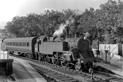 The 5.20 p.m. Bristol - Frome service in the charge of BR Standard 3MT 2-6-2T no. 82040 takes a dr4ink at Radstock West station on 9/6/59. This picturesque line was scheduled for closure on the following December 2nd. 82040 was Barrow Road allocated at the time and the unknown photographer has noted that he had ridden from Bristol on the footplate. A further footnote: I had the good fortune to traverse this line behind City of Truro in 1957. [Mike Morant collection]