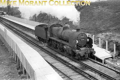 Maunsell 'N' class mogul no. 31408 runs light through Worplesdon station between Guildford and Woking on 25/4/65. [Mike Morant]