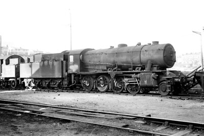 WD, Austerity 2-8-0 no. 90378 in a delapidated state at Glasgow's Eastfield shed in late May 1966. Heaven knows what it was doing there as it was a Hull Dairycoates engine at the time. [Mike Morant]