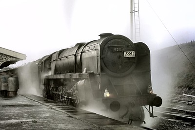 """LCGB: The """"Castle to Carlisle"""" Rail Tour 14/10/67 BR Standard 9F class 2-10-0 no. 92091 is ready for departure in fading light from Hellifield whilst in charge of the final leg of this tour which will return the participants to Liverpool Exchange station. Although 7029 Clun Castle was the star of this show it was 92091 that had started the day's proceedings from Liverpool to Preston. [Mike Morant collection]"""