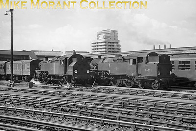 BR Standard tank engines 3MT 2-6-2T 82006 and 4MT 2-6-4T 80095 are shown here at work in the carriage sidings at Clapham Junction on 24/8/66. Also a part of our railway history are the chimneys of Lots Road power station in the background supplying power to London's Underground railways. [Mike Morant collection]