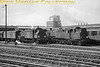 BR Standard tank engines 3MT 2-6-2T 82006 and 4MT 2-6-4T 80095 are shown here at work in the carriage sidings at Clapham Junction on 24/8/66.<br> Also a part of our railway history are the chimneys of Lots Road power station in the background supplying power to London's Underground railways.<br> [<i>Mike Morant collection</i>]